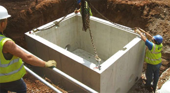 Pump chamber being lowered into the ground